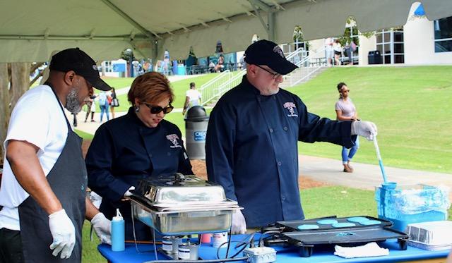 Dr. Markwood prepares pancakes for students. Photo courtesy of Skylar Diehl.
