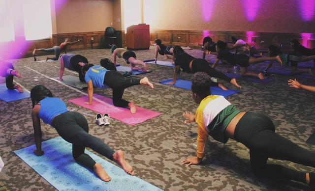 Attendees participate in the yoga class. Photo courtesy of Skylar Diehl.