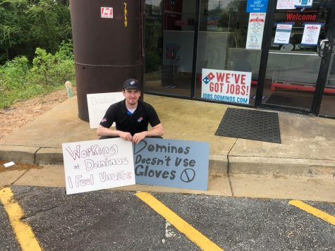 Theo Pound protests outside of the Bradley Park Domino