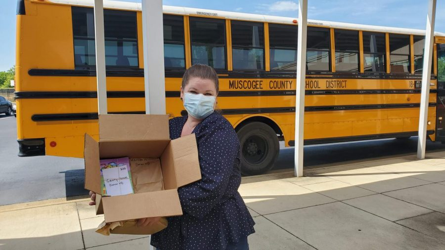 Lucy Kacir, Director of Education & Engagement at The Columbus Museum, delivers Museum From Home activity booklets to the Muscogee County School District for distribution with MCSD's meals-to-go program.