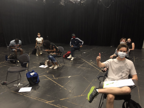 A physically distanced theatre class with taped-out areas. Photo by Macy Frazier.